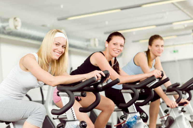 fitness-young-woman-on-gym-bike-spinning
